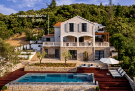 The classic Mediterranean villa with a swimming pool, surrounded by Mediterranean pine trees.