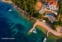 Aerial photography of the Mediterranean villa with direct sea frontage.