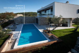 A fourteen meter long swimming pool on a large terrace in front of the house.